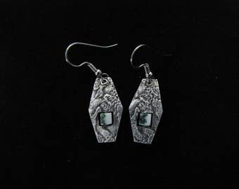 Silver, dangle earrings with stone texture, highlighted with black patina and green and white marble cube bead