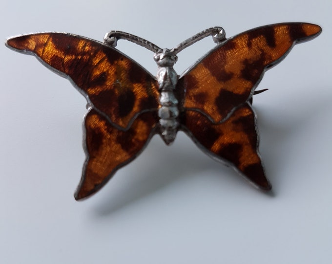 Stunning Stratnoid enamel butterfly brooch in gorgeous tortoiseshell colours. C clasp fastening. Brown and orange.