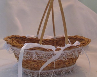 Cute wedding flower girl basket . Sweet shape and handle. Dainty embellishments with lace and satin ribbon. Semi open weave basket.