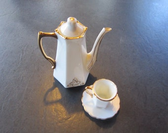 miniature teapot with cup /saucer..fine china. vtg miniatures. doll house