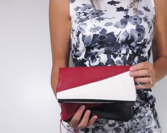 fold over clutch in color block faux leather with choice of zipper color. Holiday clutch.
