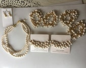 earrings in gold as pictured, necklace gold finishes with ivory pearls and 6 cluster gold and ivory bracelets.