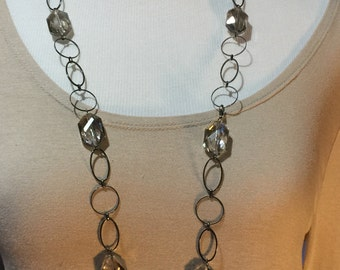 Large crystals and gunmetal chain long necklace