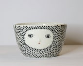 Spotty coffee bowl with sculpted face