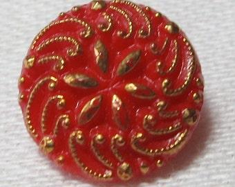 5 Glass buttons, red, vintage, raised design flower center, abstract design rim.Gold toned hi-lites, shank,STAMPED. UNK12.1-16.8-25.17.