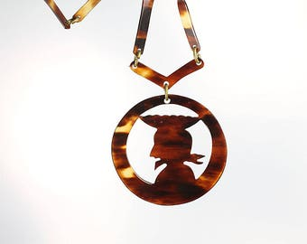 Carved Tortoise lucite Pirate Head Necklace, vintage 1960s jewelry