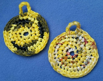 Two Plarn Dish Scrubbies, black and yellow, recycled plastic bags