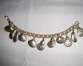 Napier shell charm bracelet gold tone clams oysters