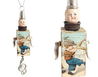 Musical Boy ornament, art doll ornament, mixed media assemblage, handmade Christmas ornament, by Elizabeth Rosen
