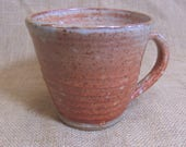 Stoneware coffee mug, tea cup. With shino glaze.