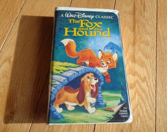 Vintage Disney Black Diamond Edition VHS Tape of The Fox and The Hound in the original plastic container in Vintage Condition.