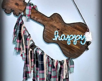 """Reclaimed Wood """"Happy"""" Guitar Shape Wall Hanging with Upcycled Plaid Rag Fringe"""
