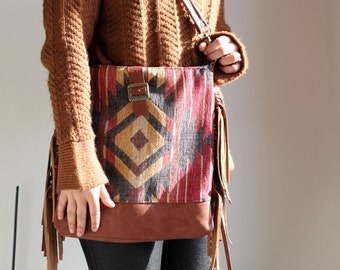 Navajo shoulder bag with brass buckle, leather fringe, medium size, geometric pattern chenille Fabric, leather shoulder strap. Ready to ship