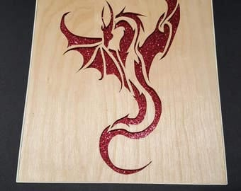 Taking Flight.  Hand-cut, woodcut of a dragon taking flight.