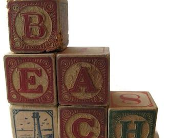 antique children's wooden building blocks, spell BEACH also lighthouse block
