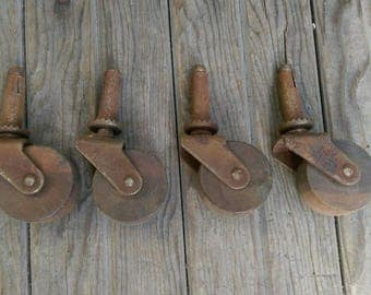 "Set of 4 Antique Wood Casters ""Faultless 7"""