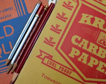 vintage office supplies: carbon paper, red pencils, typewriter and ink eraser