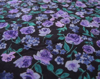 Vintage 1980s rayon fabric purple and green floral flowers on black background