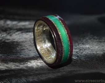 Silver half dollar coin ring with purple heart wood and emerald inlay
