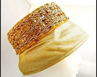 Gold   Pillbox Hat with Sequence and gold stitching design