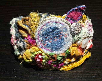 Recycled upcycled fabric hand sewn wrist cuff. Vintage Kantha fabric, button, beads, fits small to medium