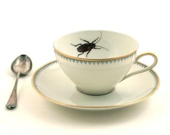 ceramic cockroach inside coffee cup