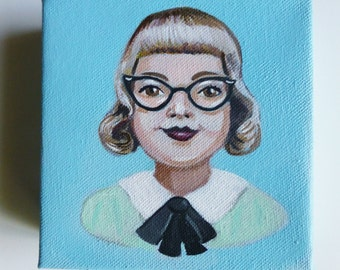 Ruby Mae, portrait of a vintage woman wearing glasses.