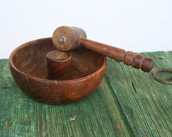 Hand carved walnut cracker bowl with hammer