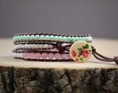 Elegant pink rose, mint, and pearl wrapped bracelet