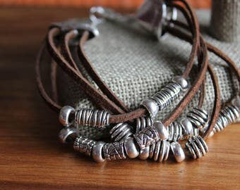 Brown suede 5-strand bracelet with silver beads and lobster claw clasp