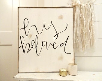 His beloved black and white rustic wood sign