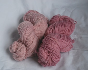 100 g wool skein, sport weight yarn, naturally hand dyed light pink with cochineal.