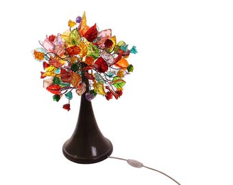 Table lamp Decor with multicolored flowers leaves and metal wires, desk lamp for saloon or bedside table.