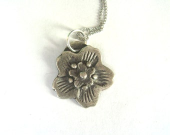 reserved for Carrie:  artisan flower pendant necklace in fine silver, two-sided