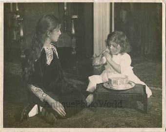Girls blowing soap bubbles antique art photo