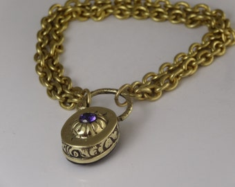 A stunning double bracelet with a double set reverse fully working large padlock