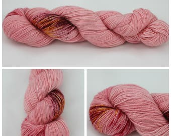 Glitz Sock - Hand Dyed Yarn - {Cheeky Lass} is a pink yarn, red yarn with deep red, maroon, and yellow speckles. sock yarn, knitting yarn.