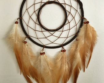 Brown dream catcher, faux suede, brown web, rooster feathers and hoop insert finish 15cm diameter dreamcatcher hand made