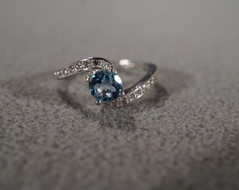 Vintage Sterling Silver Band Ring Round Blue Topaz 14 Diamond Bypass Design, Size 8