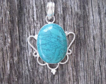 Silver Pendant with Turquoise Colored Stone