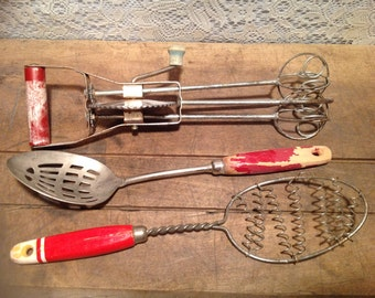 Collection of red handled utensils