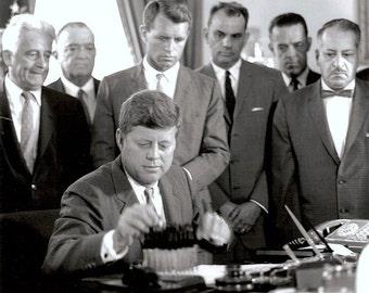 John Kennedy ,  Kennedy signs an anti crime bill.