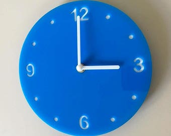 "Round Bright Blue & White Clock - White Acrylic Back, Blue Gloss Finish Acrylic with White hands, Silent Sweep Movement.  Sizes 8"" or 12"""