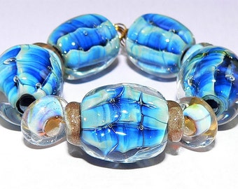 Handmade Lampwork Glass bead set of 9 graduated beads made with blue Silver Glass SRA