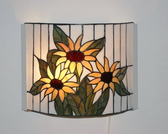 Stained glass lamp on the wall in the sunflowers