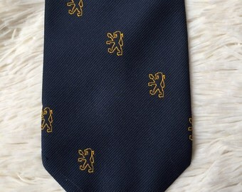 Peugeot Critter Tie - golden clasp on back - navy blue