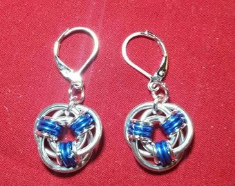 Subatomic particles earrings.