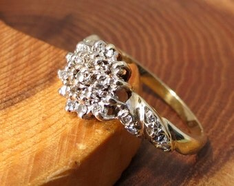 A vintage 9k yellow gold 0.25 (1/4) Carat diamond cluster ring.