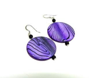 Earrings. Purple earrings. Dangle earrings. Button earrings. Mother of pearl earrings. Purple and black mother of pearl dangle earrings.