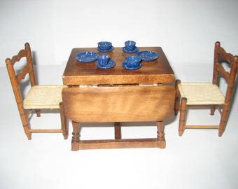 Dollhouse vintage drop leaf wooden table PLUS 2 handmade wood chairs PLUS 10 blue metal dishes (13 items total)